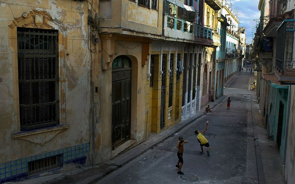 Children playing a baseball game in the streets of Havana. (Joe Raedle/Getty Images/ via JTA)