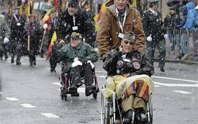 US WWII veteran Bob Izumy of the 101st AB 506, participates in a parade during the 70th anniversary of the WWII Battle of the Bulge or the Ardennes Offensive, in Bastogne, Southeastern Belgium, Saturday, Dec. 13, 2014. (photo credit: AP Photo/Yves Logghe)