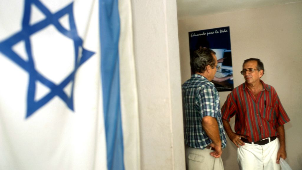 Illustrative: An Israeli flag hangs on the wall of the Jewish Community Center in Havana, Cuba. (Serge Attal/Flash90)
