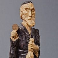 A Lucky Jew figurine holding a coin, maker unknown (photo credit: Grzegorz Mart)