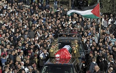 Palestinian security members drive with the coffin of senior Palestinian official Ziad Abu Ein during his funeral in the West Bank city of Ramallah on December 11, 2014. (Photo credit: AFP/ AHMAD GHARABLI)