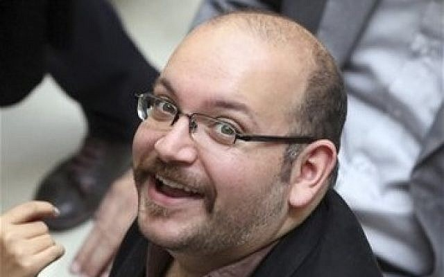 Jason Rezaian, an Iranian-American correspondent for the Washington Post, at a campaign event for President Hassan Rouhani in Tehran, Iran, April 13, 2013 (photo credit: AP/Vahid Salemi)