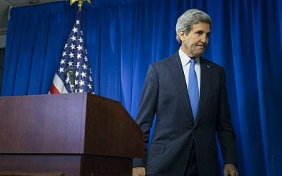 Secretary of State John Kerry at the end of a news conference at the US Embassy in London, on December 16, 2014 (photo credit: AFP/ Evan Vucci/ Pool)