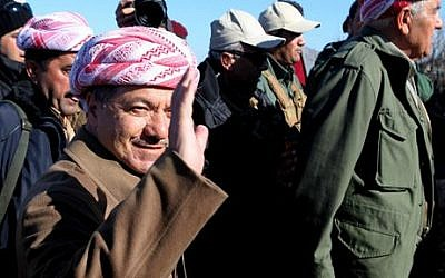 Kurdistan Iraqi regional government President Massoud Barzani arrives to support Kurdish forces as they head to battle Islamic State fighters, on the summit of Mount Sinjar, in the town of Sinjar, Iraq, Sunday, Dec. 21, 2014 (photo credit: AP/Zana Ahmed)