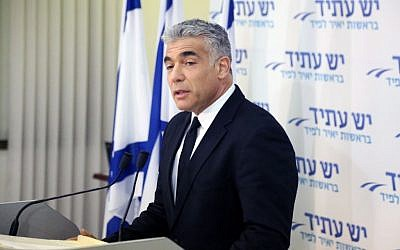 Ex-finance minister Yair Lapid speaks at a press conference in Tel Aviv, December 3, 2014. (photo credit: Flash90)