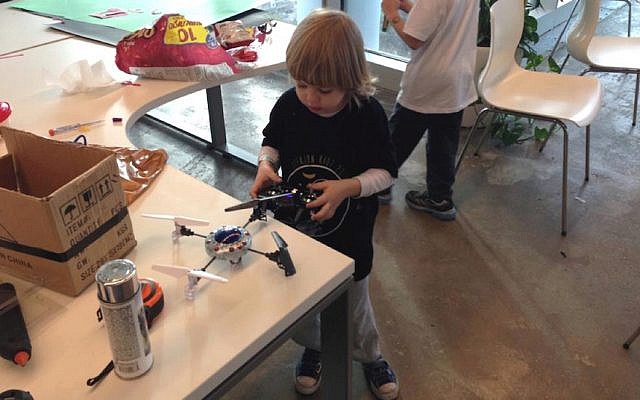 A pint-sized hacker works on a drone at last year's Geekcon Kids (Photo credit: Courtesy)