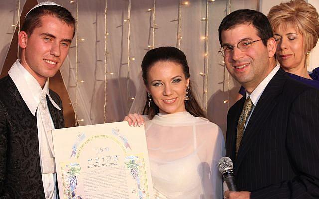 Rabbi Seth Farber, right, officiating at a wedding (photo - courtesy)