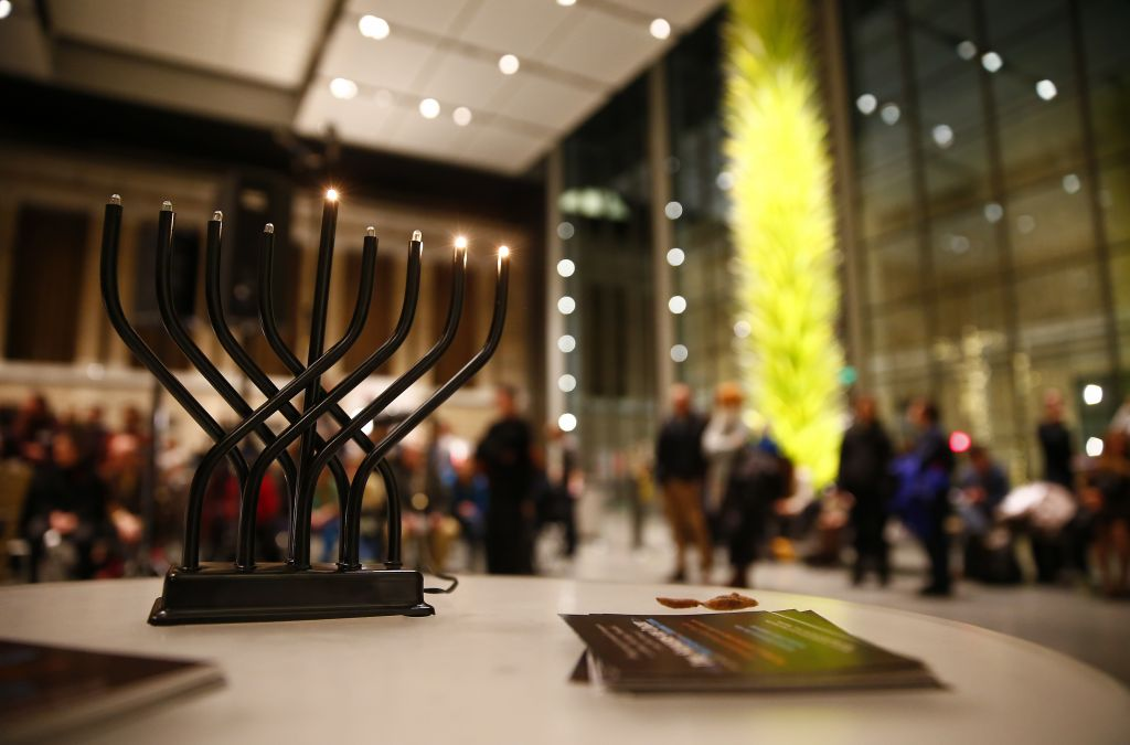An electric hanukiah glows during a performance of scenes from 'Seekers of Light' at the Museum of Fine Arts Boston on Wed. evening (photo credit: Jared Wickerham/The Times of Israel)