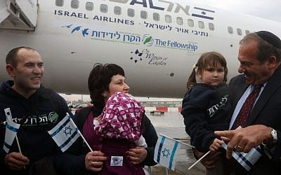 "Rabbi Yechiel Eckstein with some of the 224 Ukrainian  Jewish refugees arrive in Israel on his organization's first ""Fellowship Aliya"" flight, December 22, 2014. (photo credit: International Fellowship of Christians and Jews)"