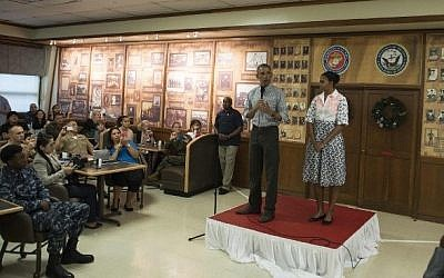 US President Barack Obama addresses troops at the US Marine Corps base in Kaneohe, Hawaii, as First Lady Michelle Obama looks on, December 25, 2014. (photo credit: AFP/Nicholas Kamm)
