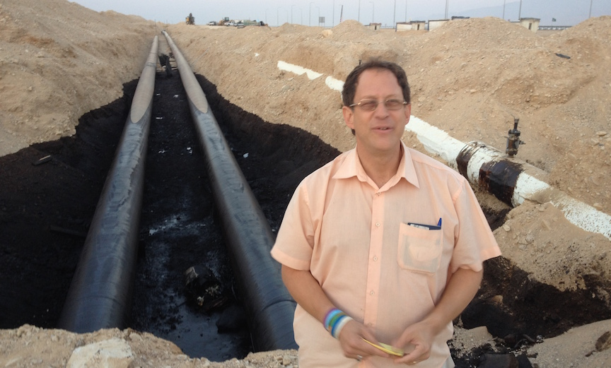 Yosef Abramowitz stands in front of the damaged portion of the Trans-Israel pipeline (Photo credit: Courtesy)