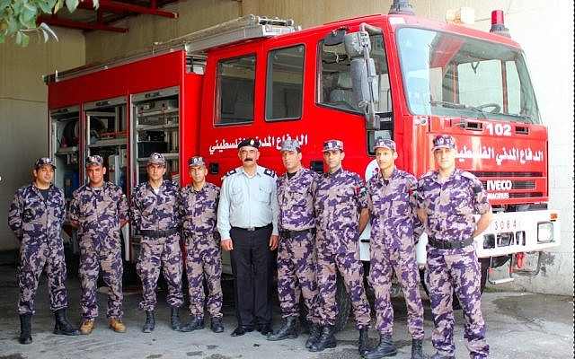 The firefighters at the Bethlehem fire station pose in front of their fire truck. (photo: Courtesy/Firelines)