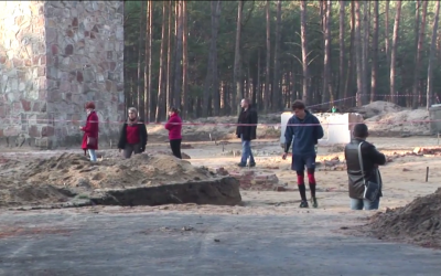 Visitors to the former Nazi death camp Sobibor, in eastern Poland, wander through the recently excavated remains of the gas chambers on Nov. 11, 2014. (photo credit: Lena Klaudel)