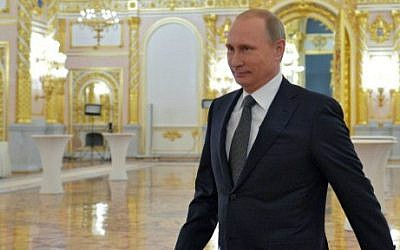 Russian President Vladimir Putin arrives to deliver his annual address at the Kremlin in Moscow on December 4, 2014 (photo credit: AFP/Ria-Novosti/Pool/Alexei Druzhinin)