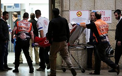 Paramedics bring victims injured in a stabbing attack to the Hadassah Ein Kerem hospital in Jerusalem on December 03, 2014. (photo credit: Noam Revkin Fenton/FLASH90)