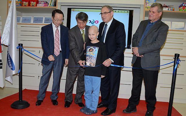 (L to R) Samsung Israel CEO Karyen Kai; South Korean ambassador to Israel Lee Gun-Tae; Or Wilhelm, a nine year old oncology patient at Schneider Children's Hospital; Professor Yosef Peres of Schneider Children's Hospital; and MK Miki Rosenthal (Photo credit: Aviv Hofi)