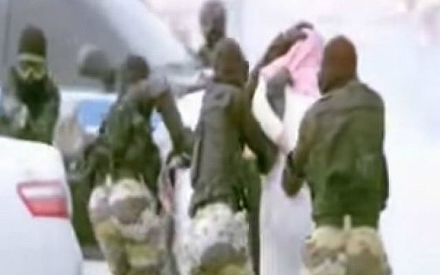 Saudi Arabian security forces arresting a 'suspect' during a training operation. (screen capture: YouTube)