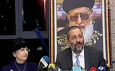 Aryeh Deri, right, and Adina Bar-Shalom speaking at a Shas party press conference in Jerusalem, December 14, 2014. (Screen capture: Channel 2)