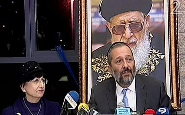 Aryeh Deri, right, and Adina Bar Shalom speaking at a Shas party press conference in Jerusalem, December 14, 2014. (Screen capture: Channel 2)
