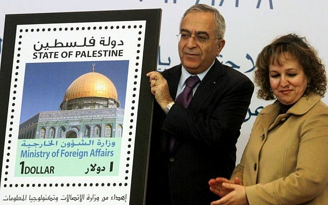 Former Palestinian prime minister Salam Fayyad participated in the unveiling of the first postage stamp bearing the name of the State of Palestine on January 28, 2013. (photo credit: Issam Rimawi/Flash90)