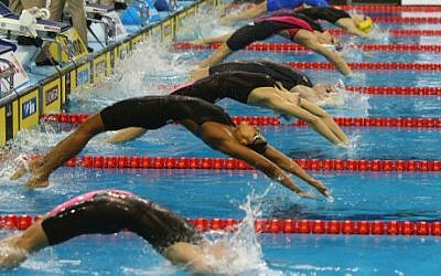Illustrative photo of swimmers competing in the Women's 50m Backstroke semi-finals during the 12th FINA World Swimming Championships in Doha, December 6, 2014 (photo credit: AFP PHOTO/Marwan Naamani)