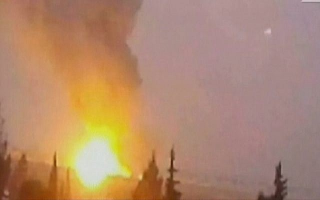 A picture said to show a fireball after an alleged Israeli strike on sites inside Syria on December 7, 2014. (Screen capture: Channel 2)