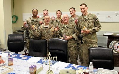 Troops with their Hannukah care packages. (Photo credit: Ava Hamburger/courtesy )