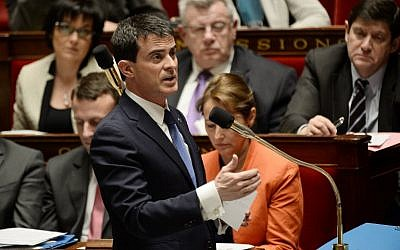 French Prime Minister Manuel Valls answers Members of Parliament's questions during a session of Questions to the Government, on January 21, 2015 at the French National Assembly in Paris. (photo credit: AFP PHOTO / STEPHANE DE SAKUTI)