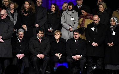 From left to right (first row): President of the Bundestag Norbert Lammert, German President Joachim Gauck, Chairman of the Central Council of Muslims in Germany Aiman Mazyek, German Chancellor Angela Merkel, German Vice Chancellor Sigmar Gabriel, and representative of Germany's Muslim community Ayten Kilicarslan pay tribute to victims of the jihadist attacks in Paris against Charlie Hebdo during a Muslim community tolerance rally on January 13, 2015 in front of Brandenburg Gate in Berlin. (photo credit: Tobias Schwarz/AFP)