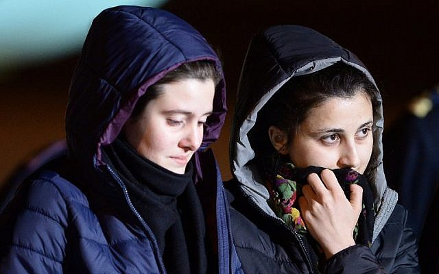 Italian aid workers abducted in Syria last summer, Greta Ramelli (L) and Vanessa Marzullo arrive at Ciampino airport in Rome early on January 16, 2015. (photo credit: AFP PHOTO / FILIPPO MONTEFORTE)
