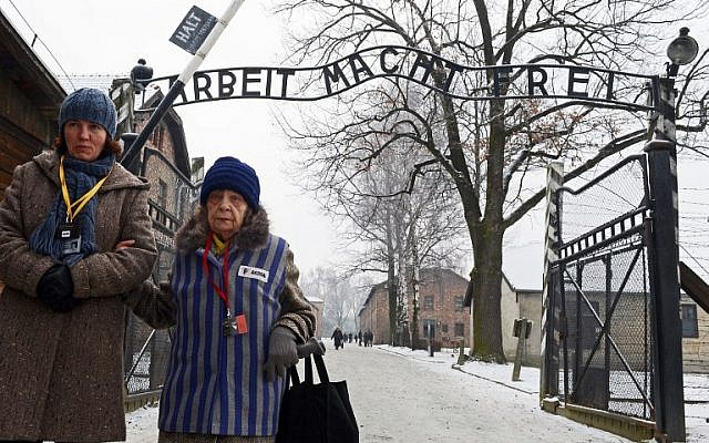 A concentration camp prisoner attending a ceremony at the memorial site of the former Nazi concentration camp Auschwitz-Birkenau on January 27, 2014. (AFP/JANEK SKARZYNSKI)