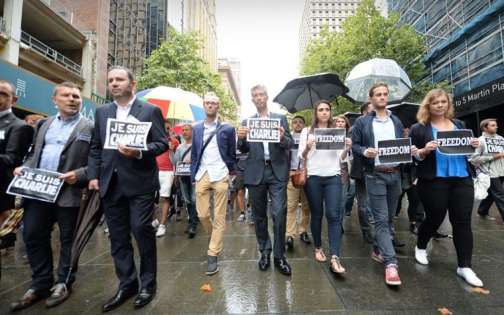 French ambassador to Australia Christophe Lecourtier (2nd L) leads members of Sydney's French community in the heart of the city to pay tribute to the Paris jihadist attack victims, near the scene of a deadly cafe siege last month in Sydney, on January 11, 2015. (photo credit: AFP PHOTO/Peter PARKS)