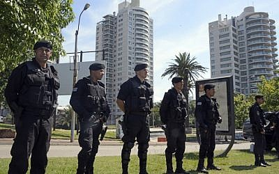 Illustrative photo of security forces standing guard near the World Trade Center Montevideo, which houses offices of the Israeli embassy, on January 8, 2015 (AFP/Mario Goldman)