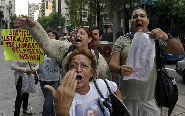 A woman holds a sign reading 'Justice, justice, justice for the death of prosecutor Nisman' during a demonstration in front of the National Congress in Buenos Aires on January 19, 2015. (photo credit: AFP/Juan Vargas)