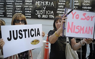 Women hold placards that read 'Justice' and 'I Am Nisman' during a rally in front of the headquarters of the AMIA memorial in Buenos Aires on January 21, 2015, to protest against the death of Argentine public prosecutor Alberto Nisman. (photo credit: AFP/Alejandro PAGNI)