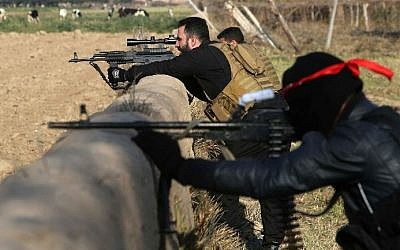 Pro-Iraqi government fighters take part in an operation to secure an area they seized from the Islamic State (IS) militants, December 29, 2014. (photo credit: AFP/ MOHAMMED SAWAF)