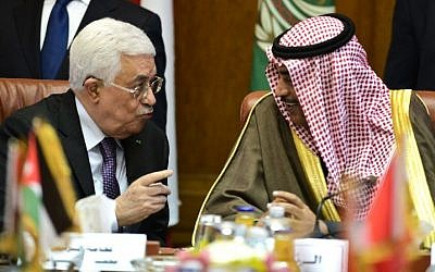 Palestinian Authority President Mahmoud Abbas (L) talks to Kuwaiti Foreign Minister Sabah al-Khaled al-Sabah during a meeting at the Arab League headquarters in Cairo on January 15, 2015. (photo credit: Mohamed el-Shahed/AFP)