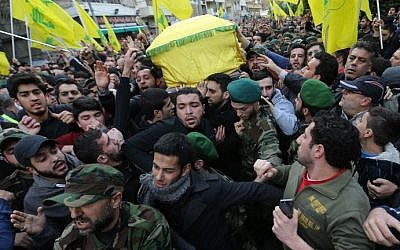 Lebanese Hezbollah supporters carry the coffin of Jihad Mughniyeh, killed in an alleged Israeli airstrike,  during his funeral in a southern Beirut suburb on January 19, 2015. (photo credit: Joseph Eid/AFP)