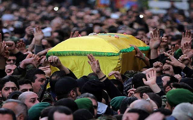 Hezbollah supporters carry the coffin of militant Jihad Mughniyeh during his funeral in a southern Beirut suburb on January 19, 2015. (photo credit: AFP PHOTO /JOSEPH EID)