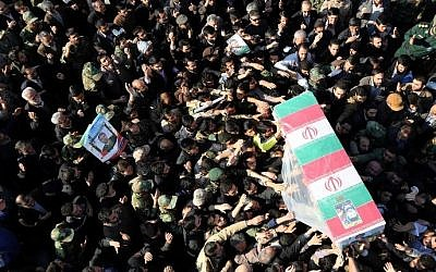 Iranian mourners carry the coffin of Brigadier General Mohammad Ali Allahdadi, a commander of the Islamic republic's Revolutionary Guards killed in an Israeli air strike on the weekend on Syria, during his funeral procession in Tehran on January 21, 2015.  (AFP/ATTA KENARE)