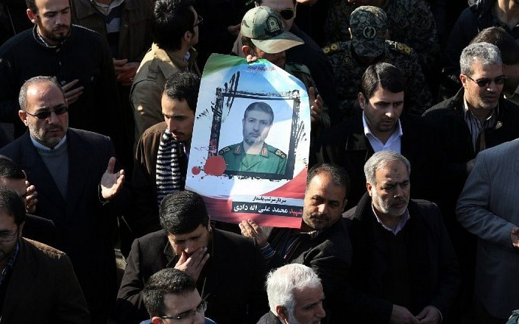 Illustrative: Iranian mourners carry a portrait of Brigadier General Mohammad Ali Allahdadi, a commander of the Islamic republic's Revolutionary Guards killed in a reported Israeli air strike on Syria, during his funeral procession in Tehran on January 21, 2015. ( AFP/ATTA KENARE)
