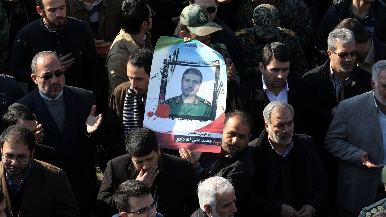 Iranian mourners carry a portrait of Brigadier General Mohammad Ali Allahdadi, a commander of the Islamic republic's Revolutionary Guards killed in a reported Israeli air strike on Syria, during his funeral procession in Tehran on January 21, 2015. (Photo credit: AFP/ATTA KENARE)