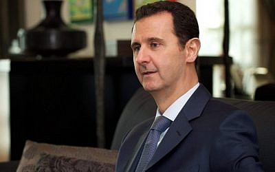 Syrian President Bashar Assad gives an interview to Foreign Affairs magazine in Damascus, January 26, 2015. (AFP)