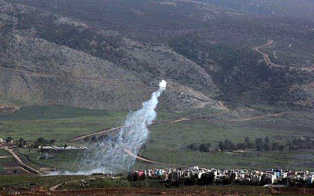 Smoke from Israeli shelling covers the Lebanese town of Al-Majidiyah on the Lebanese border with Israel on January 28, 2015. (photo credit:AFP/ALI DIA)