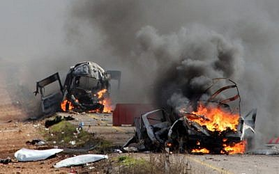 Israeli military vehicles are seen burning following a Hezbollah missile strike across the border on January 28, 2015. Two IDF soldiers were killed in the attack. (photo credit: AFP/MARUF KHATIB)