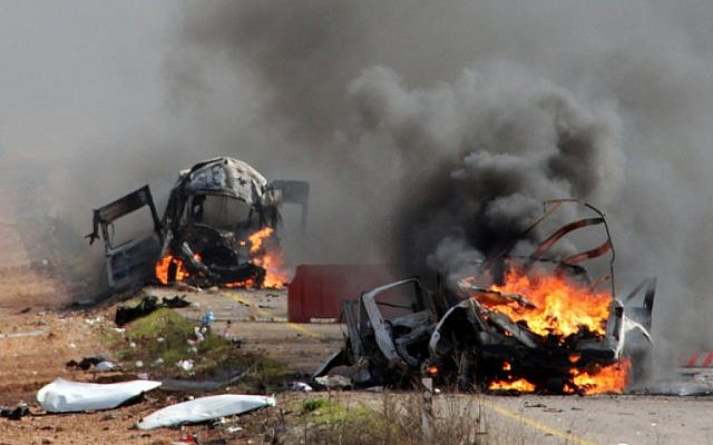 Israeli military vehicles are seen burning following a Hezbollah missile strike on January 28, 2015. (photo credit: AFP/MARUF KHATIB)