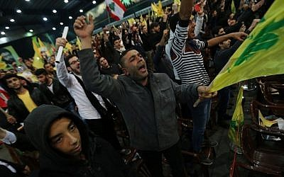Hezbollah supporters shout slogans during a speech by the group's leader Hassan Nasrallah on January 30, 2015 in Beirut (Photo credit: Joseph Eid/AFP)