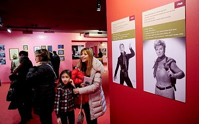 "A picture taken on December 20, 2014 in Istanbul shows people visiting the ""Here I am, Zeki Muren"" exhibition. (photo credit: AFP/OZAN KOSE)"