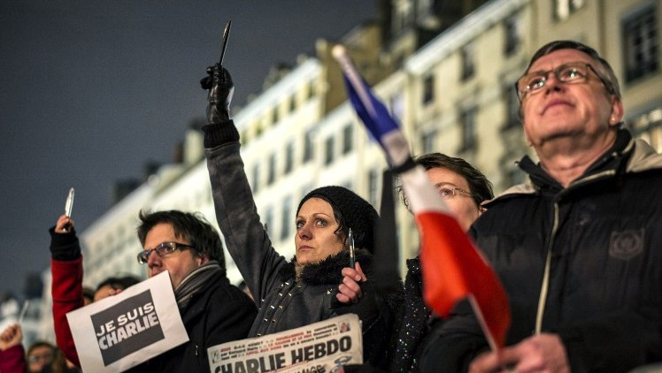 A vigil in Lyon on January 7, 2015, following an attack by unknown gunmen on the offices of the satirical weekly, Charlie Hebdo in the capital. (photo credit: AFP/JEFF PACHOUD)