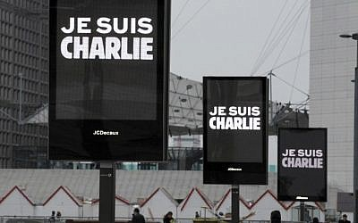 "Signs read ""Je suis Charlie"" (I am Charlie) near La Defense in Paris before the nation observed a minute of silence on January 8, 2015 for the 12 victims of an attack by armed gunmen on the offices of French satirical newspaper Charlie Hebdo in Paris the day before.  (photo credit: AFP/ERIC PIERMONT)"